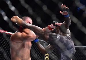 "Feb 2, 2019; Fortaleza, CE, Brazil; Junior ""Baby"" Albini (red gloves) vs. Jair ""Bigi Boi"" Rozenstruik (blue gloves) during UFC Fight Night at Arena CFO. Mandatory Credit: Jason Silva-USA TODAY Sports"